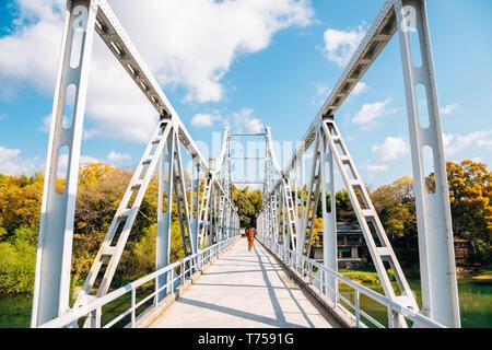 Old bridge on Asahi river near Okayama Castle in Japan - Stock Photo