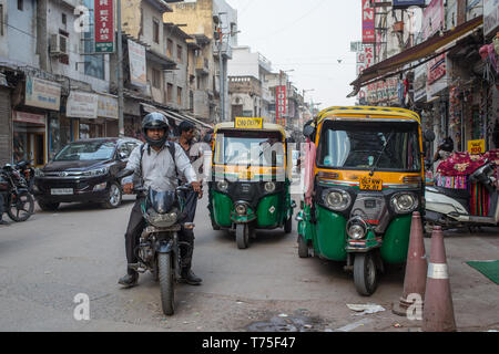 Taxi rickshaws waiting for customers at the famous main bazar in New Delhi, India - Stock Photo