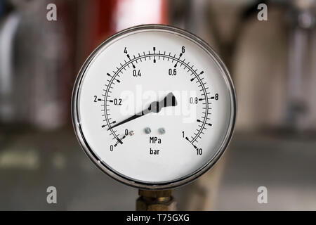 Metal industrial pressure gauge - Stock Photo