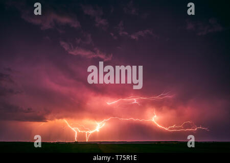 Lightning with dramatic clouds image . Night thunder-storm in Lithuania - Stock Photo