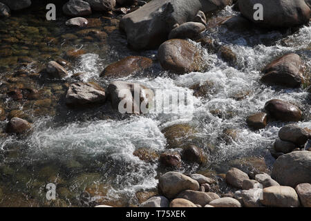 Rocks in the Solenzara River Parc Naturel Regional de Corse Corsica France - Stock Photo