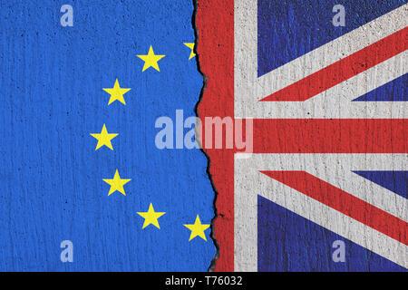 Britain flag breaking apart from European Union flag - Brexit concept - Stock Photo