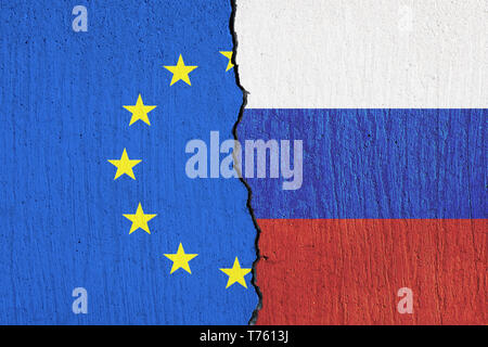 flag of the European Union and the flag of Russia painted on wall - Stock Photo