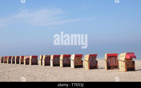 multiple beach chairs in a row on a deserted beach of the Baltic See in Germany - Stock Photo