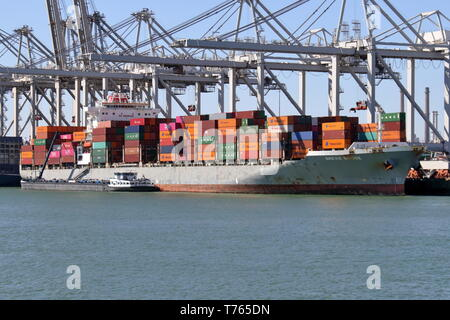 The container ship Brevik Bridge will be loaded and unloaded in the port of Rotterdam on April 10, 2019. - Stock Photo