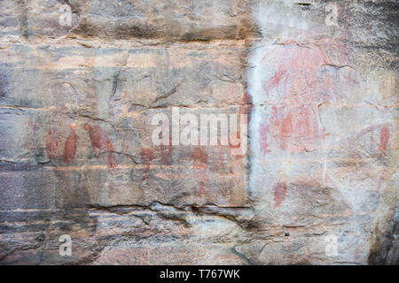 Aboriginal rock art on the natural stone surfaces at Kakadu National Park in the Northern Territory of Australia - Stock Photo