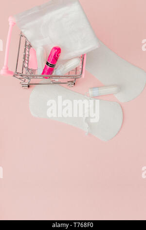 Women intimate hygiene products - sanitary pads and tampons on pink background, copy space. Menstrual period concept. Top view, flat lay, copy space. - Stock Photo