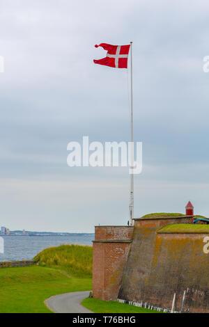 Danish flag near Kronborg castle in Denmark - Stock Photo