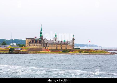 Kronborg Castle on the shore in Helsingor - Stock Photo