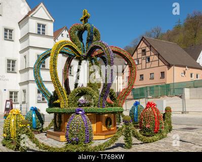 KIPFENBERG, GERMANY - APRIL 19: Traditionally decorated easter fountain in Kipfenberg, Germany on April 19, 2019. Foto taken from Marktplatz. - Stock Photo
