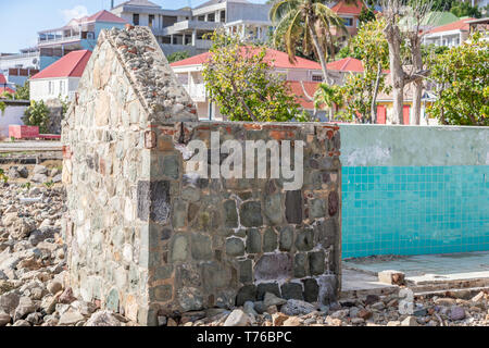 a colorful depiction of a sail boat on scrap wood in Gustavia, St Barts - Stock Photo