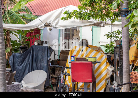 A yard in Gustavia, St Barts that is full of junk - Stock Photo