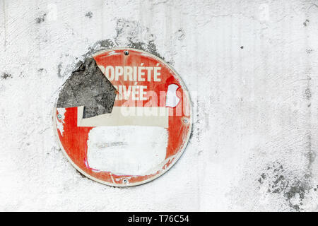 old traffic sign on the side of a building in Gustavia, St Barts - Stock Photo