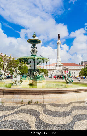 Largo do Rossio  Dom Pedro IV Square with Dom Pedro IV monument, Teatro Nacional Dona Maria II National Theatre and fountain - Stock Photo