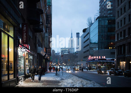 MARCH 2017 MANHATTAN, NY. Broadway ave at sunset. the blizzard makes the night cold and empty in the streets. - Stock Photo