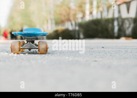 blue children's skateboard in the Park on a Sunny summer day. - Stock Photo