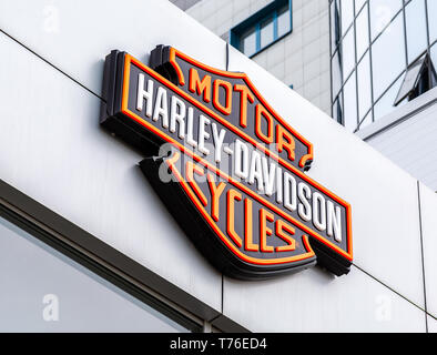 Samara, Russia - May 3, 2019: Logo of Harley-Davidson Inc. is an American motorcycle manufacturer. Harley Davidson brand is famous among bikers around - Stock Photo