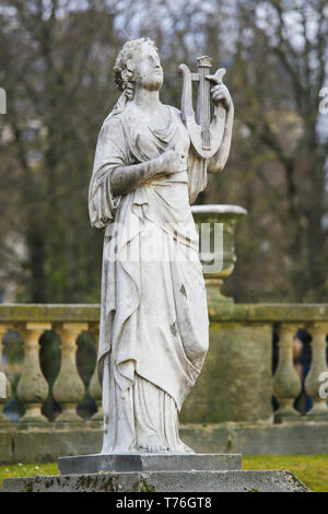 Statue of Calliope, in Greek Mythology the muse who presides over eloquence and epic poetry, holding a lyre in the Jardin de Luxembourg, Paris, France - Stock Photo