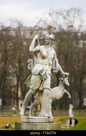 Statue of Diana, a Roman goddess of the hunt, the Moon, and nature, associated with wild animals and woodland in the Jardin du Luxembourg, Paris, Fran - Stock Photo