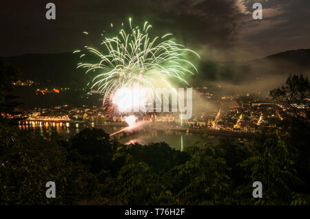 Beautiful view on Heidelberg at night during castle illumination with colourfull bright fireworks captured in a long time exposure - Stock Photo
