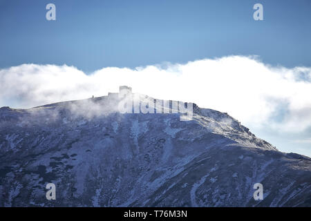 Abandoned snow-covered observatory on the mountain Pip Ivan, called White Elephant in the Carpathian mountains.Winter time - Stock Photo