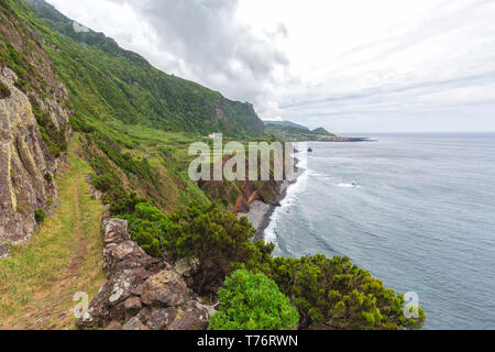 A hiking trail nearby the Ponta da Faja village on Flores island in the Azores. - Stock Photo
