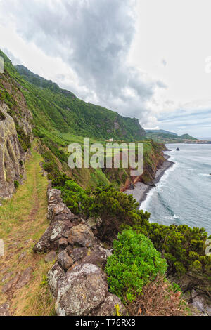 A portrait view of a hiking trail near Ponta da Faja village on Flores island in the Azores. - Stock Photo