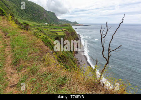 A hiking trail near Ponta da Faja village on Flores island in the Azores. - Stock Photo