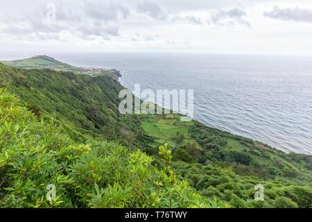 Green view from the Miradouro da Faja do Conde of Santa Cruz das Flores in the Azores. - Stock Photo