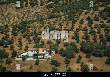 Rural landscape with small farmhouse encircled by green trees and fields at Elvas. A gracious city on the easternmost frontier of Portugal. - Stock Photo