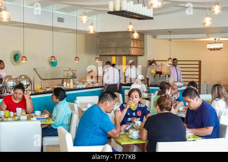 Cartagena Colombia El Laguito Hotel Dann Cartagena hotel restaurant free included breakfast buffet Hispanic resident residents man woman family guests - Stock Photo