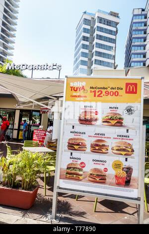 Cartagena Colombia Bocagrande McDonald's hamburgers fast food restaurant sign promotions combos menu Spanish language - Stock Photo