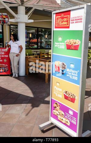 Cartagena Colombia Bocagrande McDonald's hamburgers fast food restaurant sign promotions Spanish language - Stock Photo