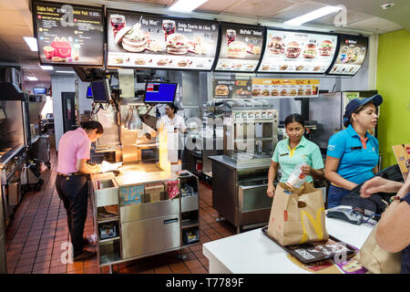 Cartagena Colombia Bocagrande McDonald's hamburgers fast food restaurant inside counter Hispanic resident residents employees workers cashiers order t - Stock Photo