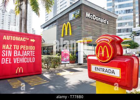 Cartagena Colombia Bocagrande McDonald's hamburgers fast food restaurant drive thru through exterior Spanish language Automac Spanish language entranc - Stock Photo