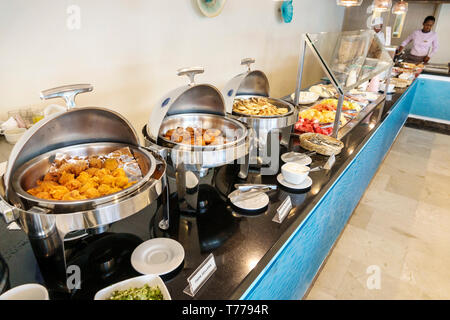 Cartagena Colombia El Laguito Hotel Dann Cartagena hotel restaurant free included breakfast buffet brunch fried potatoes chicken nuggets chafing warmi - Stock Photo