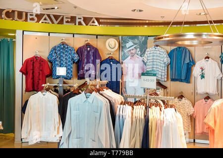 Miami Florida Miami International Airport MIA shopping concession Cubavera men's shirts traditional guayaberas linen front entrance display sale - Stock Photo