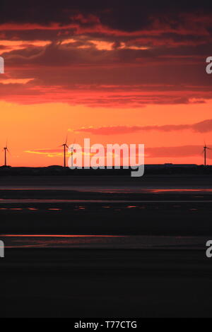 Roanhead, Barrow-In-Furness, Cumbria, UK. 4th May 2019. UK Weather. Sunset from Sandscale Haws National Nature Reserve, Roanhead. View towards the distant windfarm on the Cumbrian Coast UK. Credit : greenburn / Alamy Live News. - Stock Photo
