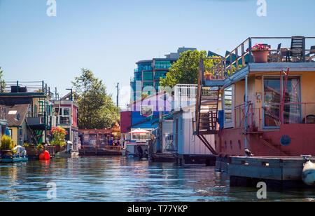 Quaint, floating houseboats in Fisherman's Wharf in Victoria, British Columbia, Canada. - Stock Photo