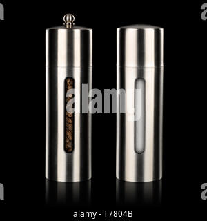 Salt and pepper grinders isolated on black background - Stock Photo