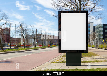 Blank advertisement mock up in the street - Stock Photo