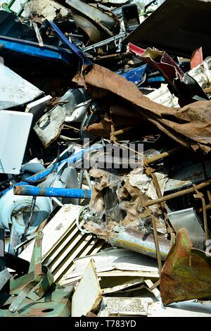 Scrap yard, scrap metal on waste dump in a recycling company - Stock Photo