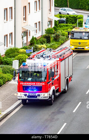 Essen / Germany - April 29 2019 : Fire fighters helping to extinguish burning apartment - Stock Photo