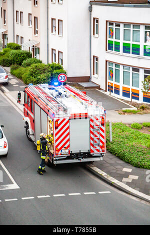 ESSEN / GERMANY - APRIL 29 2019 Fire fighters helping to extinguish burning apartment - Stock Photo