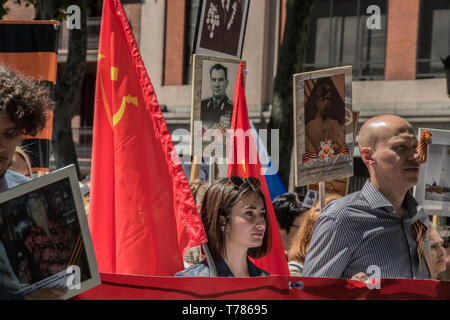 People seen with a flag of Soviet Union in the celebration of world war II, in prado avenue in Madrid, Spain. celebration of the Soviet Union in its v - Stock Photo