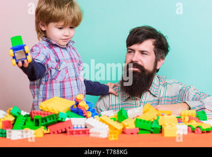 Spending time with family. small boy with dad playing together. love. child development. happy family leisure. building with constructor. father and son play game. funny holiday. play on holiday. - Stock Photo