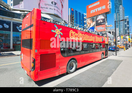 Toronto, Ontario, Canada-20 March, 2019: Toronto sightseeing hop-on hop-off bus that goes to city main tourists attractions - Stock Photo
