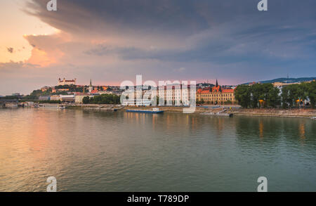 Cityscape of Bratislava, Slovakia at Sunset  as Seen from a Bridge over Danube River Towards Old Town of Bratislava. - Stock Photo