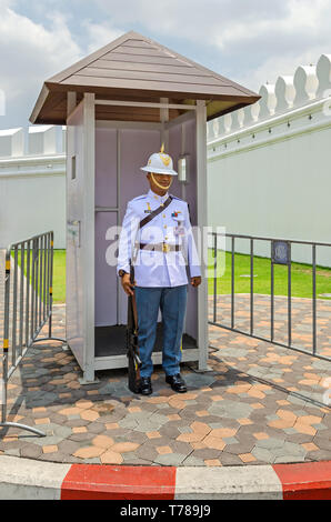 Bangkok, Thailand - April 18, 2018: Soldier of the First Infantry Regiment of the King's Guards at the entrance in the Outer Court of the Grand Palace - Stock Photo