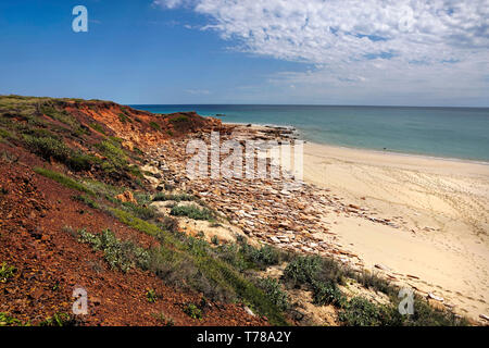 pristine untouched rugged coastline lined by the heavenly blue Indian ocean in Western Australia - Stock Photo